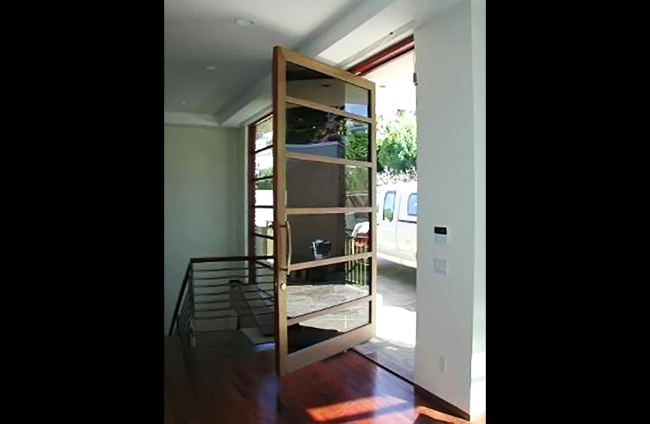 Bronze cald oversized pivot door - Laguna Beach, California | Wood Art Design