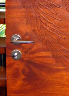 Koa wood and copper clad lift and slide doors